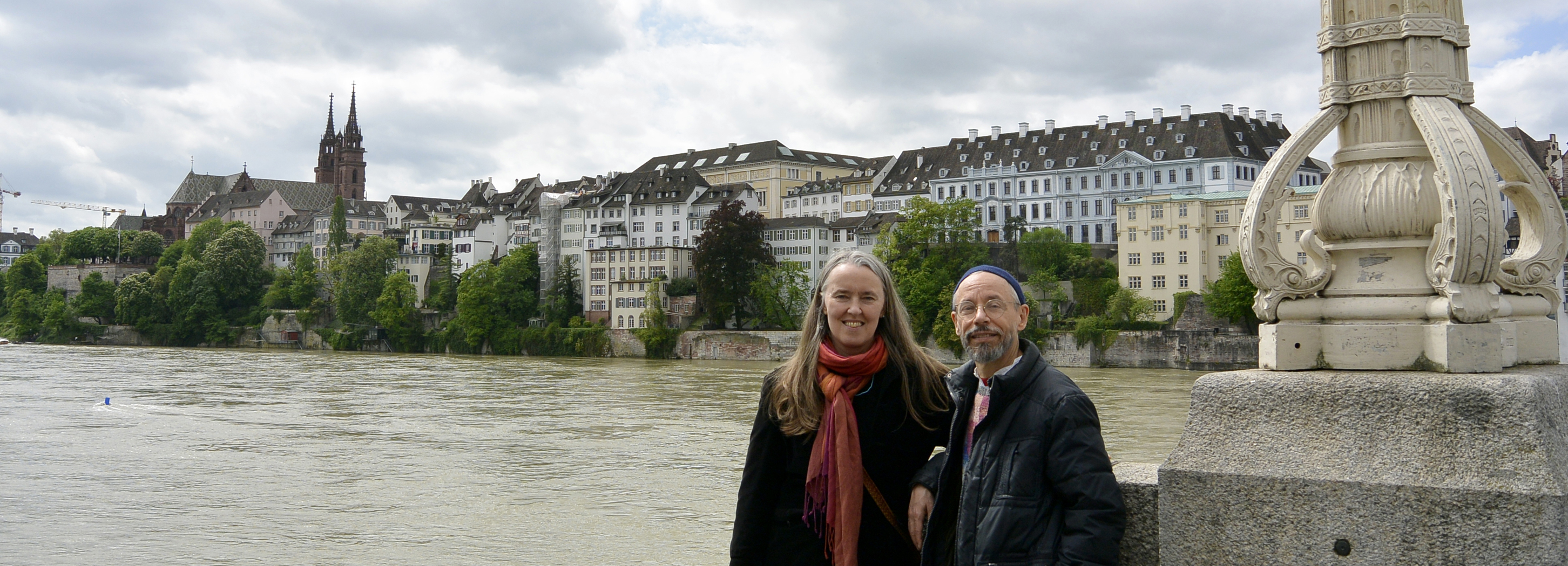 Image of Jutta and Terran standing along the Rhein River in Basel, Switzerland.
