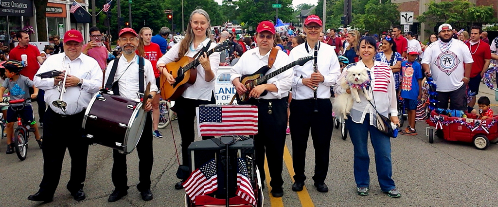Image of Jutta & the Hi-Dukes (tm) performing as a marching band in a July Fourth parade.
