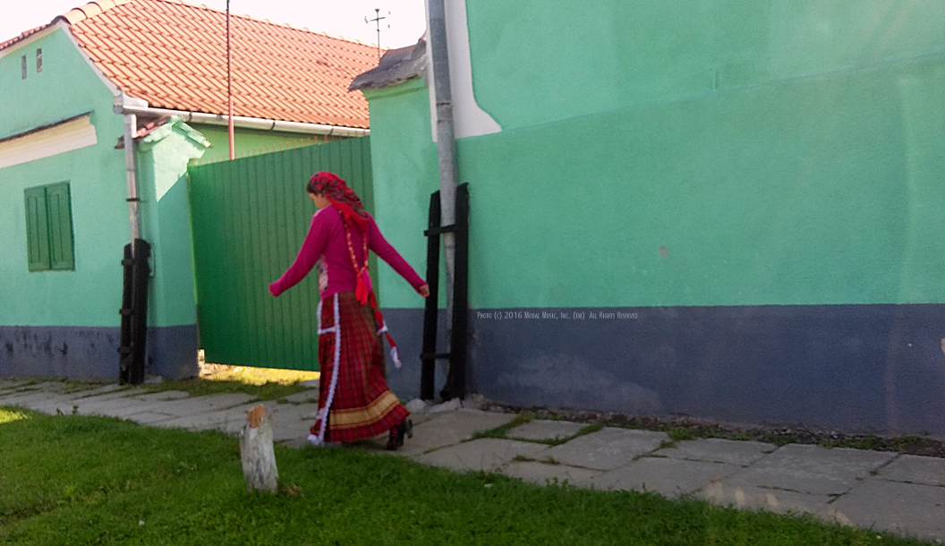 Image of lady in fushia skirt in Hosman, Romania