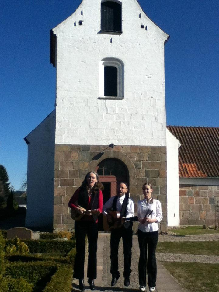 Image of Hi-Dukes levitating in front of the Linde Kirke in Denmark during the Hi-Dukes March 2012 European tour. © 2012 Modal Music, Inc. (tm) All rights reserved.