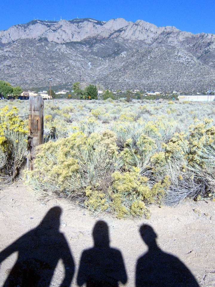 Image of the shadows of Jutta & the Hi-Dukes (tm) in front of the Sandia (Watermelon) mountain range, October 2012. © 2012 Modal Music, Inc. (tm) All rights reserved.