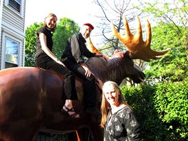 Image of Jutta & the Hi-Dukes (tm) on the back of a huge fiberglass moose at their Norwegian Independence Day concert at Will' Northwoods Inn, May 2013 © 2013 Modal Music, Inc. (tm) All rights reserved.