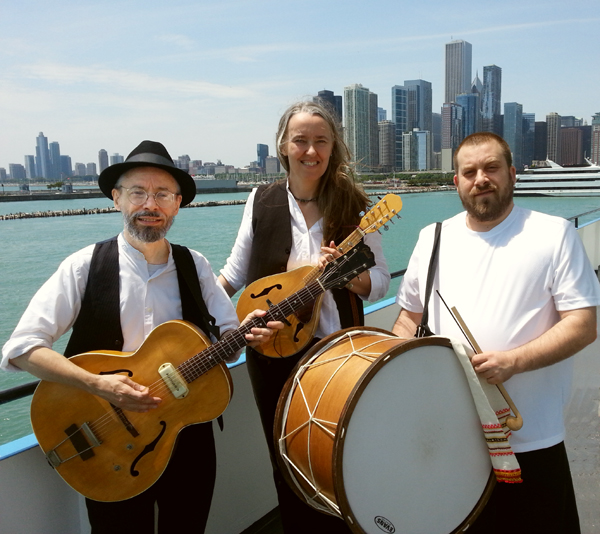 Photo of Jutta & the Hi-Dukes (tm) as a trio – Terran Doehrer, on left – guitar, Jutta Distler, in back – mandolin, Konstantin Marinov, on right – tupan. Photo copyright 2013 Modal Music, Inc. (tm). All rights reserved.