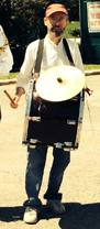 Terran playing a tupan with a cymbal mounted on top.