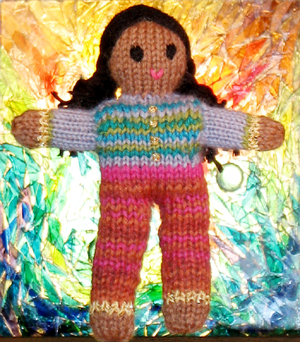Image of Girl version of Globe Toddlers (tm) Hand-knit Little People by Jutta Distler.